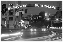 Broadway at night with lights from moving cars. Burlingame,  California, USA (black and white)