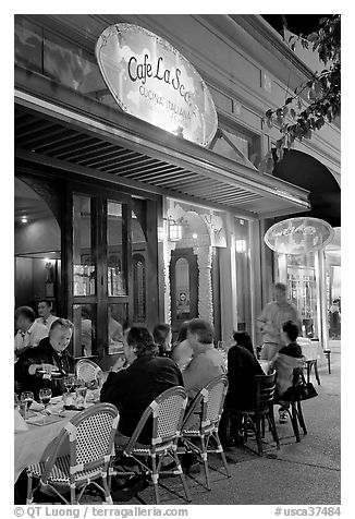 Italian restaurant with diners by night. Burlingame,  California, USA (black and white)