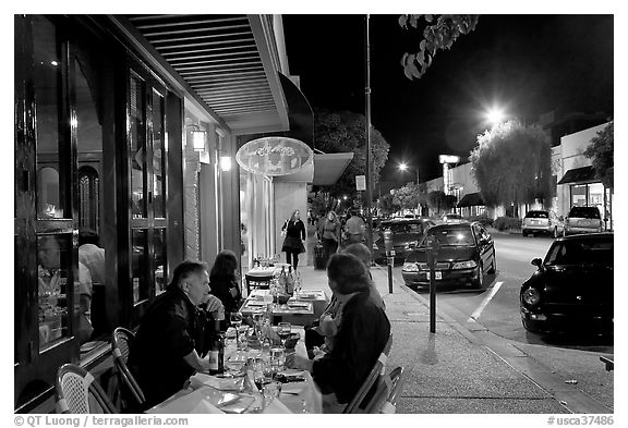 Sidewalk with Outdoor restaurant table and people walking. Burlingame,  California, USA (black and white)