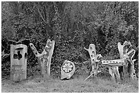 Wood carvings in garden. Half Moon Bay, California, USA ( black and white)