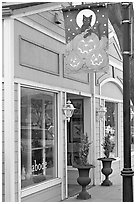 Storefront on Main Street with Halloween street decor. Half Moon Bay, California, USA (black and white)