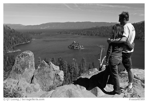 Couple standing above Emerald Bay, Lake Tahoe, California. USA (black and white)