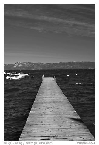 Dock, small boats, and blue waters, West shore, Lake Tahoe, California. USA (black and white)