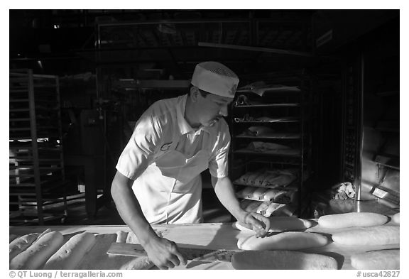 Baker preparing San Francisco sourdough bread. San Francisco, California, USA (black and white)