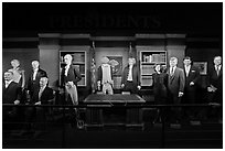 Wax figures of presidents with one outlier, Madame Tussauds. San Francisco, California, USA (black and white)