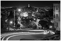 Sharp switchbacks on Russian Hill with Telegraph Hill in the background, night. San Francisco, California, USA ( black and white)