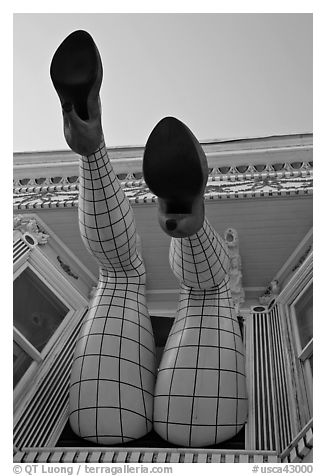 Legs with fishnet stockings hanging from a window, Haight-Ashbury District. San Francisco, California, USA (black and white)