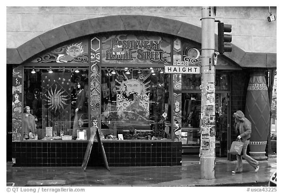 Rainny sidewalk and store with psychadelic colors. San Francisco, California, USA (black and white)