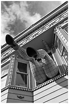 Giant legs with stockings hanging from a second floor, Haight-Ashbury District. San Francisco, California, USA (black and white)