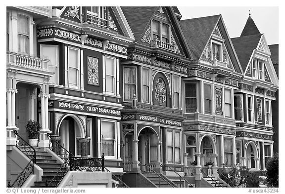 Row of elaborately decorated victorian houses. San Francisco, California, USA (black and white)