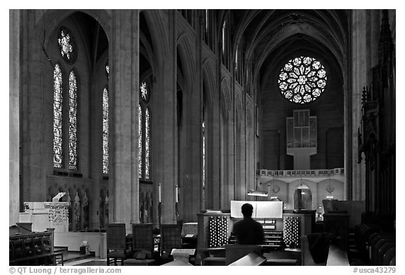 Church organist playing inside Grace Cathedral. San Francisco, California, USA (black and white)