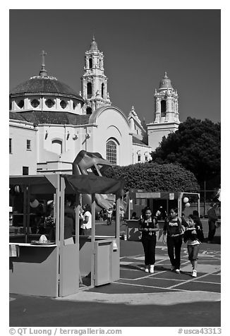 School fair booth, children, and Mission Dolores in the background. San Francisco, California, USA (black and white)