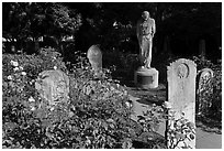Gravestones and statue, Mission Dolores. San Francisco, California, USA (black and white)