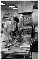 Man preparing pizza, Haight-Ashbury district. San Francisco, California, USA ( black and white)