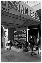 Russian Bakery with redhead woman walking out. San Francisco, California, USA (black and white)