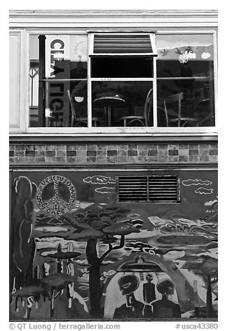 Decor from beatnik period and window reflecting city light sign, North Beach. San Francisco, California, USA (black and white)