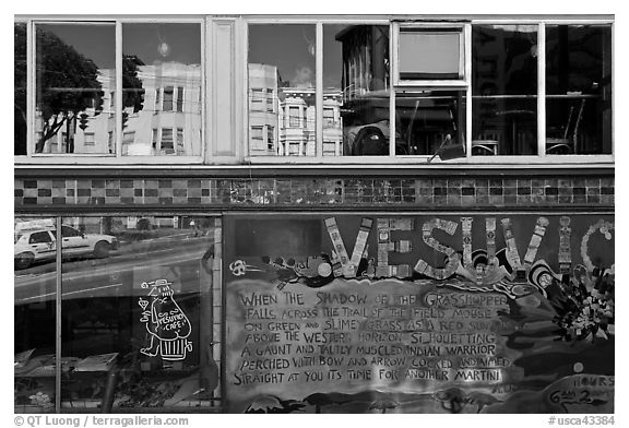Beatnik area mural and windows with Vesuvio icon and many reflections, North Beach. San Francisco, California, USA (black and white)