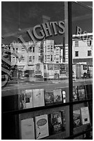 City Light Bookstore storefront with street reflections, North Beach. San Francisco, California, USA (black and white)