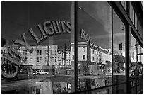 City Light Bookstore window glass and city reflections, North Beach. San Francisco, California, USA ( black and white)