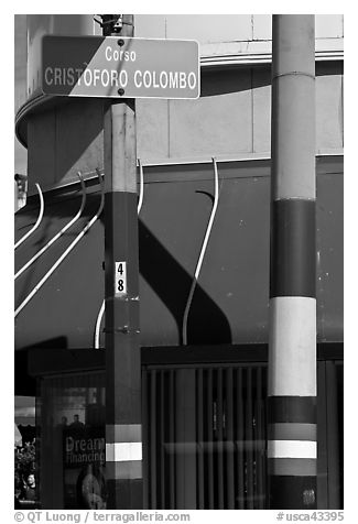 Italian flags painted on lamp posts and name of street in Italian, Little Italy, North Beach. San Francisco, California, USA (black and white)