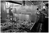 Crabs at outdoor food vending booths, Fishermans wharf. San Francisco, California, USA ( black and white)