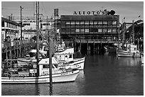 Aliotos restaurant and fishing fleet, Fishermans wharf. San Francisco, California, USA ( black and white)