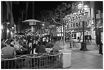 People dining at outdoor restaurant, Third Street Promenade. Santa Monica, Los Angeles, California, USA ( black and white)