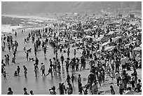 Dense crowds on beach. Santa Monica, Los Angeles, California, USA ( black and white)