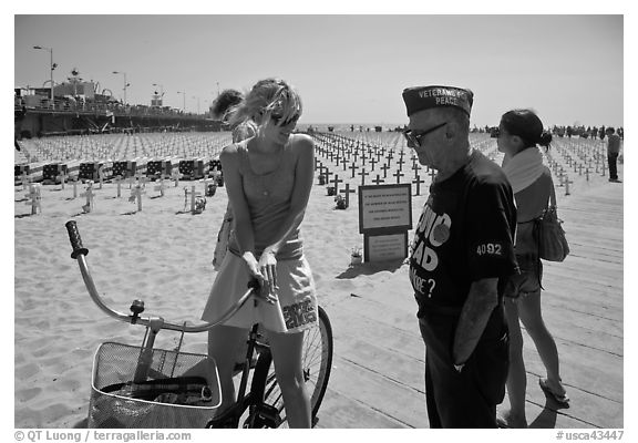 Veteran for peace conversing with woman on bicycle. Santa Monica, Los Angeles, California, USA (black and white)