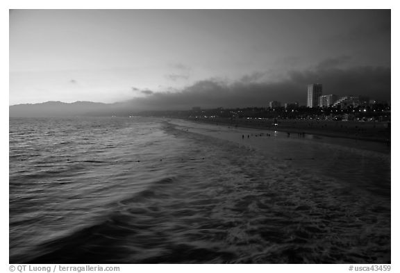 Ocean and beachfront at sunset. Santa Monica, Los Angeles, California, USA (black and white)