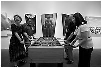 Playing soccer table game in art gallery, Bergamot Station. Santa Monica, Los Angeles, California, USA ( black and white)