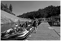 Deck with family preparing a boat, Shasta Lake. California, USA (black and white)
