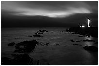 Night coastal scene with ocean and Lighthouse, Point Arena. California, USA ( black and white)