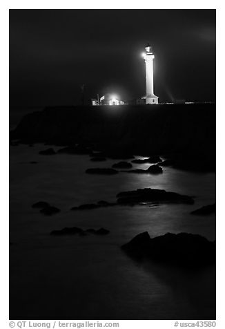 Lighthouse and reflection in surf at night, Point Arena. California, USA (black and white)