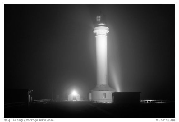 Fog and Point Arena Lighthouse by night. California, USA (black and white)