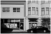 Street with brighly painted buildings, Mission District. San Francisco, California, USA ( black and white)