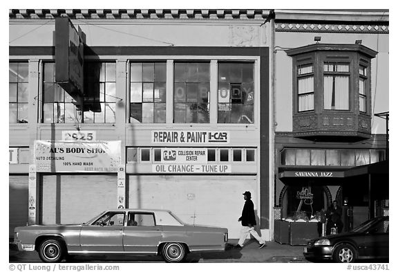 Old car and sidewalk, Mission Street, Mission District. San Francisco, California, USA (black and white)