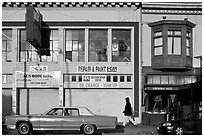 Old car and sidewalk, Mission Street, Mission District. San Francisco, California, USA ( black and white)