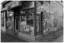Corner store and mural, Mission District. San Francisco, California, USA ( black and white)