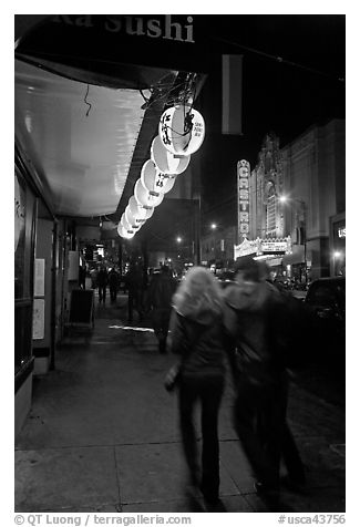 Couple on Castro street at night. San Francisco, California, USA (black and white)