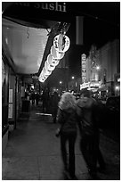 Couple on Castro street at night. San Francisco, California, USA ( black and white)