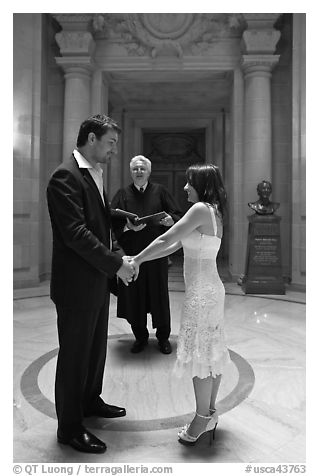 Bride, groom, and wedding officant, City Hall. San Francisco, California, USA (black and white)