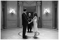 Couple taking marriage wows, City Hall. San Francisco, California, USA ( black and white)