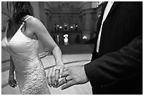 Newly wed couple holds hands, showing ring, City Hall. San Francisco, California, USA ( black and white)