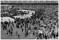 Audience and graduates mingling in stadium after commencement. Stanford University, California, USA ( black and white)