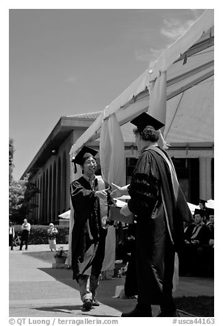 Student receiving handshake prior diploma award. Stanford University, California, USA (black and white)