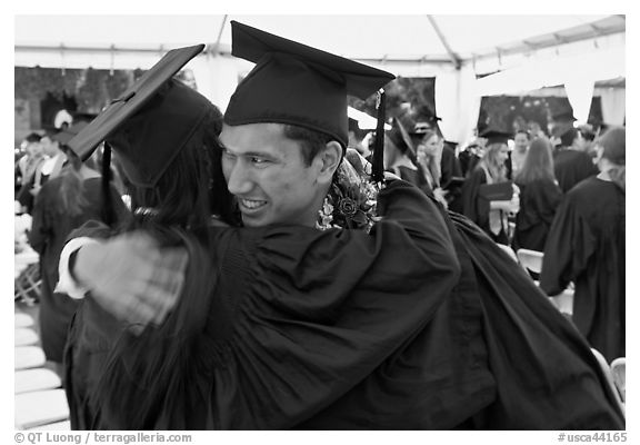 Just graduated students hugging each other. Stanford University, California, USA (black and white)