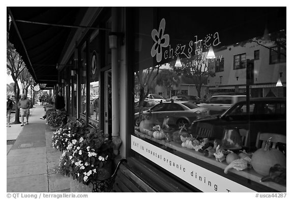 Main street reflected in storefront. Half Moon Bay, California, USA (black and white)