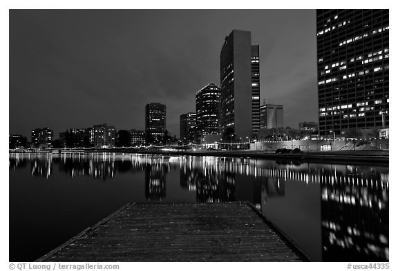 High-rise buildings, deck, and Lake Meritt, dusk. Oakland, California, USA (black and white)