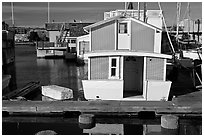 Houseboat, Oakland Alameda harbor. Alameda, California, USA (black and white)